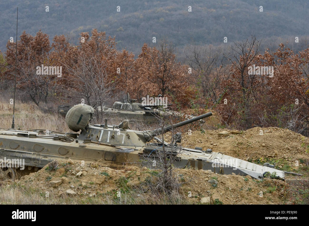 Bulgarian soldiers place the Boyevaya Mashina Pekhoty 1s (BMP -1) in a hull-down battle position during Exercise Peace Sentinel at Novo Selo Training Center, Bulgaria, Nov. 21, 2015. The BMP-1 is a Soviet amphibious tracked infantry fighting vehicle. (U.S. Army photo by Staff Sgt. Steven M. Colvin) - Stock Image