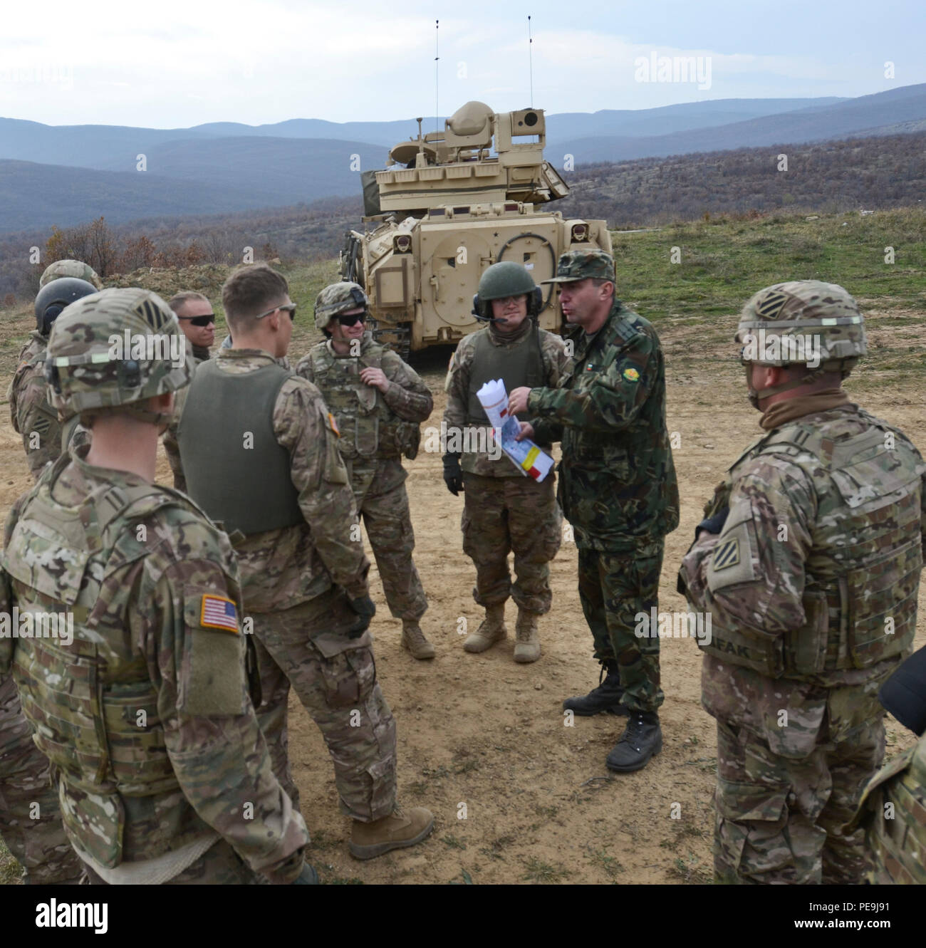 Bulgarian and U.S. Army key leaders and soldiers conduct an after action review (AAR) during Exercise Peace Sentinel at Novo Selo Training Center, Bulgaria, Nov. 21, 2015. An AAR is a professional discussion of an event or exercise that is focused on performance and standards. It allows soldiers and leaders to discuss what actions could use improvements and what actions should be sustained. (Photo by Staff Sgt. Steven M. Colvin/Released) - Stock Image