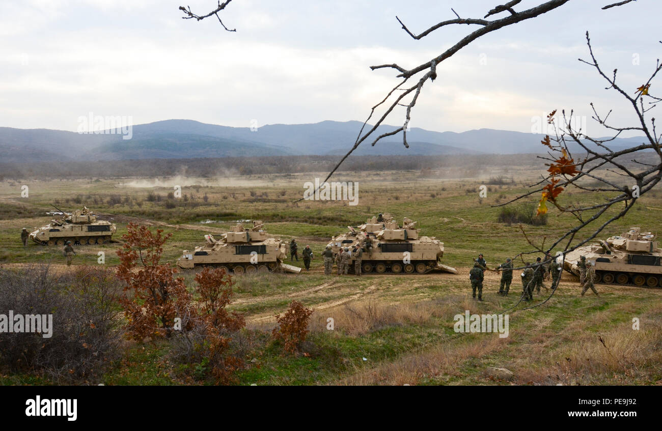 Bulgarian and U.S. Army soldiers make their way to the rally point during Exercise Peace Sentinel at Novo Selo Training Center, Bulgaria, Nov. 21, 2015. (Photo by Staff Sgt. Steven M. Colvin/Released) - Stock Image
