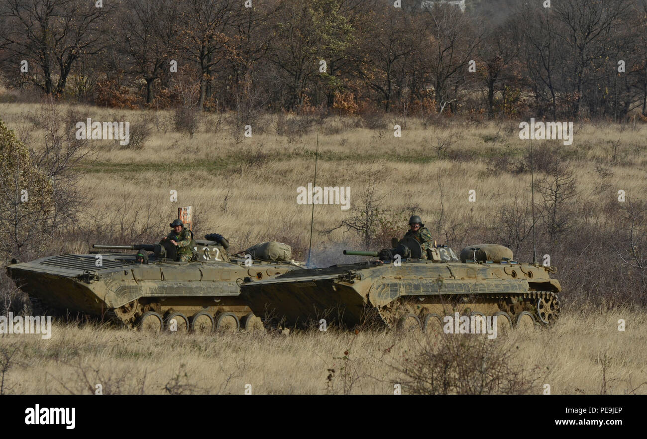 Bulgarian soldiers begin movement of the offensive line with their Boyevaya Mashina Pekhotys 1 (BMP -1P) during Exercise Peace Sentinel at Novo Selo Training Center, Bulgaria, Nov. 22, 2015. (U.S. Army photo by Staff Sgt. Steven M. Colvin/Released) - Stock Image