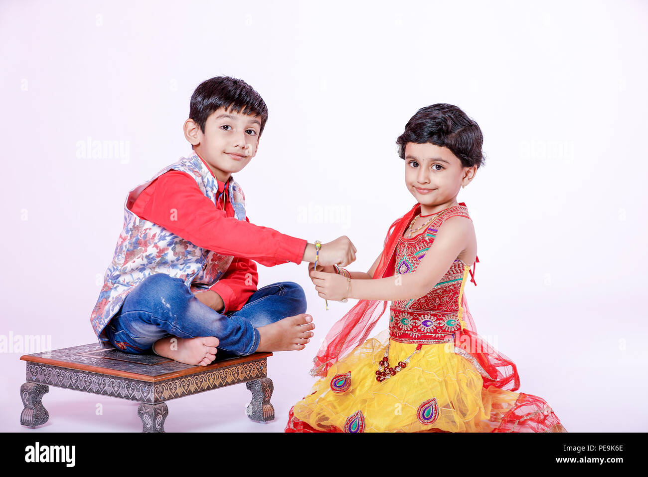 cute Indian brother and sister celebrating raksha bandhan festival - Stock Image
