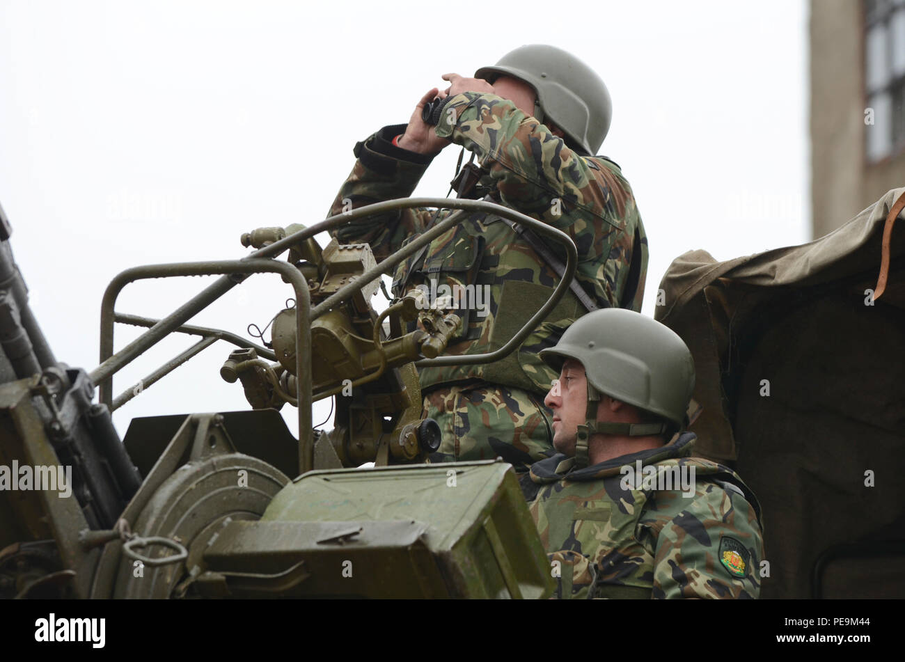 Bulgarian soldiers of 1-61st Mechanized Battalion watch for possible enemy airstrikes during Exercise Peace Sentinel at Novo Selo Training Center, Bulgaria, Nov. 24, 2015. (U.S. Army photo by Staff Sgt. Steven M. Colvin/Released) - Stock Image