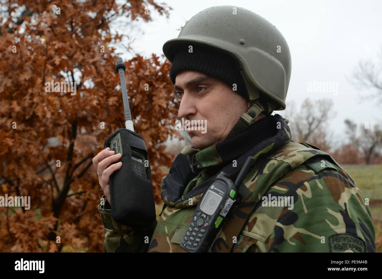 A Bulgarian soldier of 1-61st Mechanized Battalion listens to the radio for further instructions during Exercise Peace Sentinel at Novo Selo Training Center, Bulgaria, Nov. 24, 2015. (U.S. Army photo by Staff Sgt. Steven M. Colvin/Released) - Stock Image