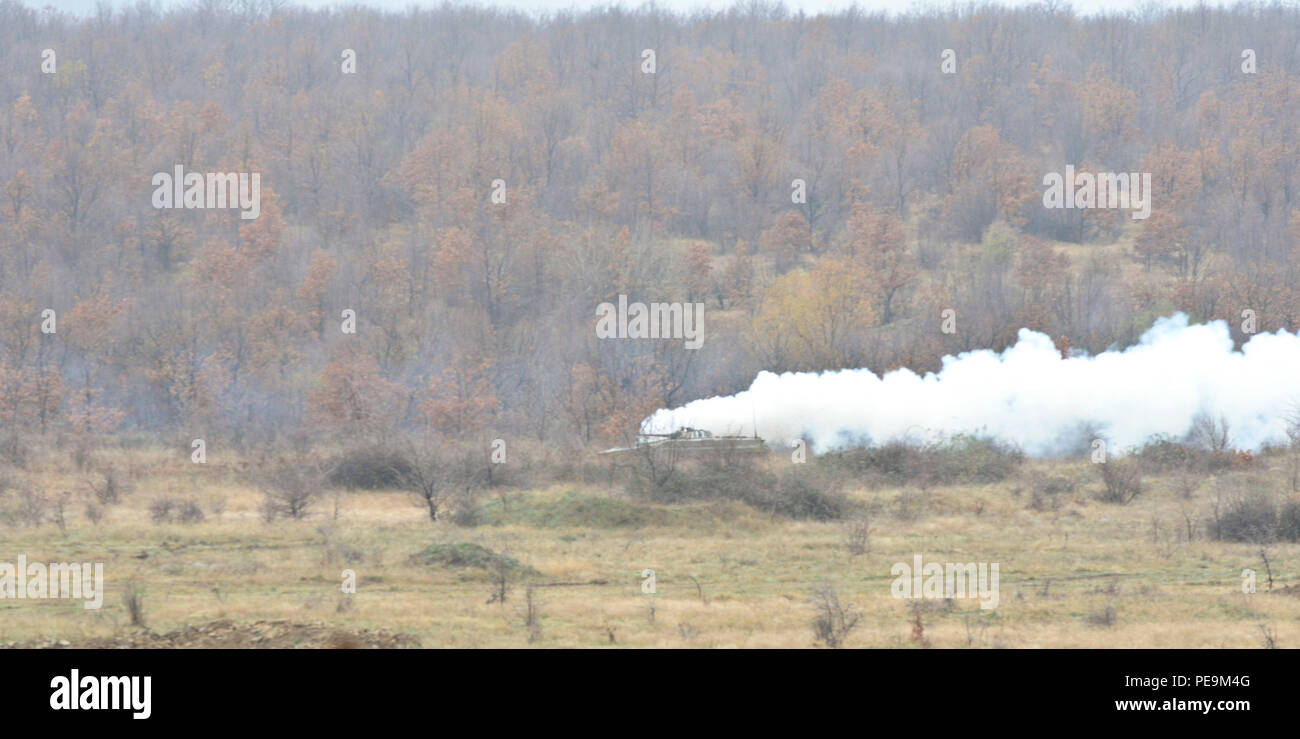 Bulgarian soldiers of 1-61st Mechanized Battalion use a Boyevaya Mashina Pekhoty 1 (BMP -1) to release a vast amount of smoke to conceal the movement of troops during Exercise Peace Sentinel at Novo Selo Training Center, Bulgaria, Nov. 24, 2015. (U.S. Army photo by Staff Sgt. Steven M. Colvin/Released) - Stock Image