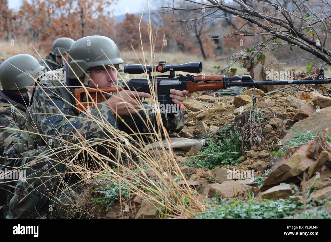 A Bulgarian soldier of 1-61st Mechanized Battalion looks through the scope mounted on a Dragunov Sniper rifle toward the enemy during Exercise Peace Sentinel at Novo Selo Training Center, Bulgaria, Nov. 24, 2015. (U.S. Army photo by Staff Sgt. Steven M. Colvin/Released) - Stock Image