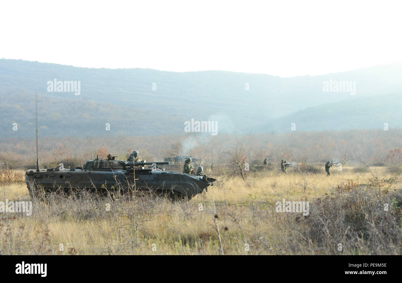 Bulgarian soldiers of 1-61st Mechanized Battalion engage fire on the enemy during Exercise Peace Sentinel at Novo Selo Training Center, Bulgaria, Nov. 24, 2015. (U.S. Army photo by Staff Sgt. Steven M. Colvin/Released) - Stock Image