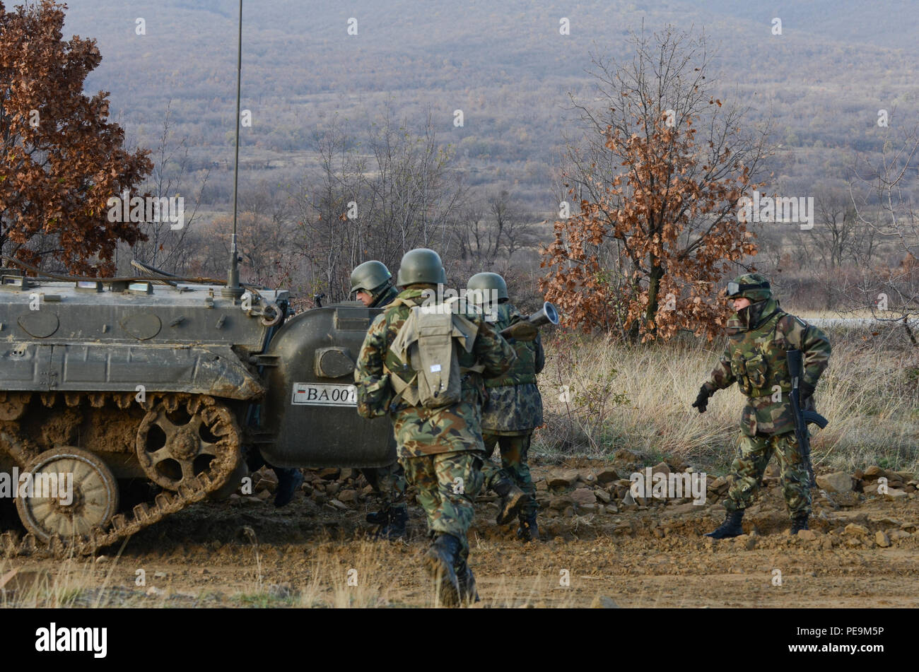 Bulgarian soldiers of 1-61st Mechanized Battalion rush to mount a Boyevaya Mashina Pekhoty 1 (BMP -1) as their team leader directs them during Exercise Peace Sentinel at Novo Selo Training Center, Bulgaria, Nov. 24, 2015. (U.S. Army photo by Staff Sgt. Steven M. Colvin/Released) - Stock Image