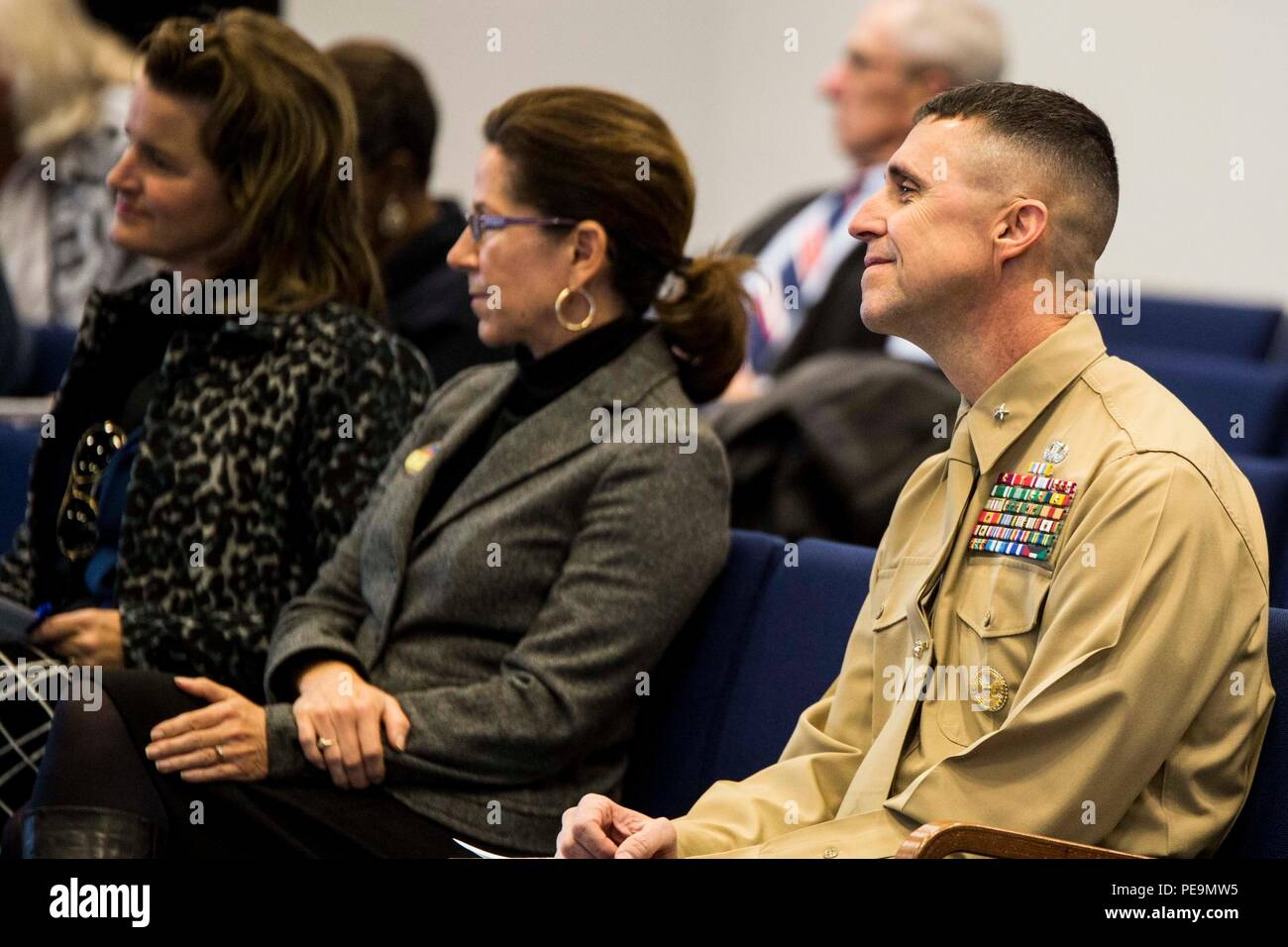 Brig. Gen. Robert Castellvi, deputy commanding general of II Marine Expeditionary Force, and other guests listen to speakers during the Onslow Forum which discussed the 'Protect What You've Earned' campaign at Jacksonville City Hall, Nov. 24, 2015. The campaign, led by II Marine Expeditionary Force, was designed as a way to encourage Marines and sailors to make sound and responsible decisions when it comes to drinking, decrease alcohol related incidents and increase force preservation. Attending the forum where representatives from the Chamber of Commerce, Duke Energy Progress, Onslow County B - Stock Image