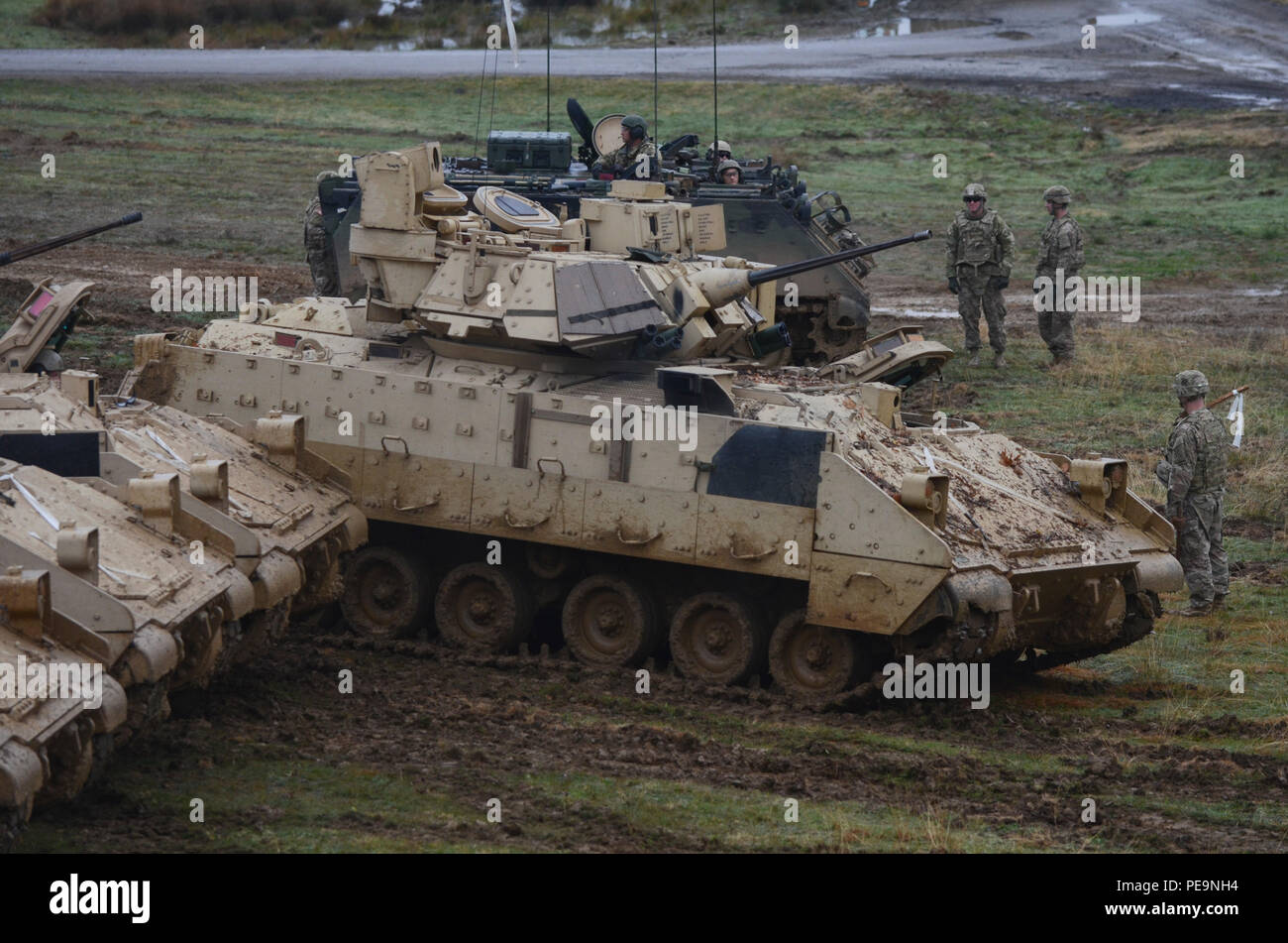 U.S. Army Soldiers of 5th Squadron, 7th Cavalry Regiment, 3rd Infantry Division, stationed at Fort Stewart, Ga., line the Bradley Fighting Vehicles into a formation for the closing ceremony of Exercise Peace Sentinel at Novo Selo Training Center, Bulgaria, Nov. 24, 2015. (U.S. Army photo by Staff Sgt. Steven M. Colvin/Released) - Stock Image