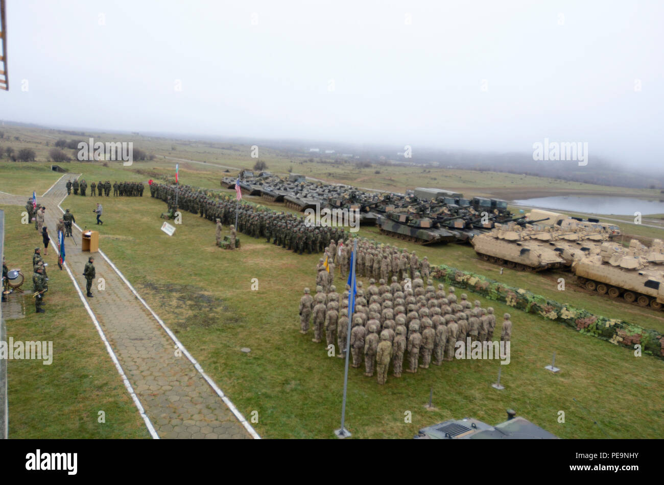 U.S. and Bulgarian Soldiers, along with their armored vehicles, form up for the closing ceremony of Exercise Peace Sentinel at Novo Selo Training Center, Bulgaria, Nov. 24, 2015. (U.S. Army photo by Staff Sgt. Steven M. Colvin/Released) - Stock Image