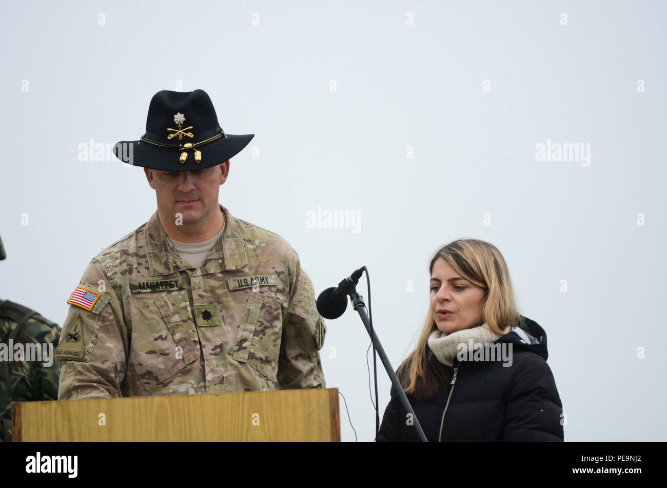 U.S. Army Lt. Col. Christopher Mahaffey, commander of 5th Squadron, 7th Cavalry Regiment, 3rd Infantry Division, stationed at Fort Stewart, Ga., comments during the closing ceremony of Exercise Peace Sentinel at Novo Selo Training Center, Bulgaria, Nov. 24, 2015. Kristina Brunson (right), a linguist, interprets the Bulgarian language into English. (U.S. Army photo by Staff Sgt. Steven M. Colvin/Released) - Stock Image