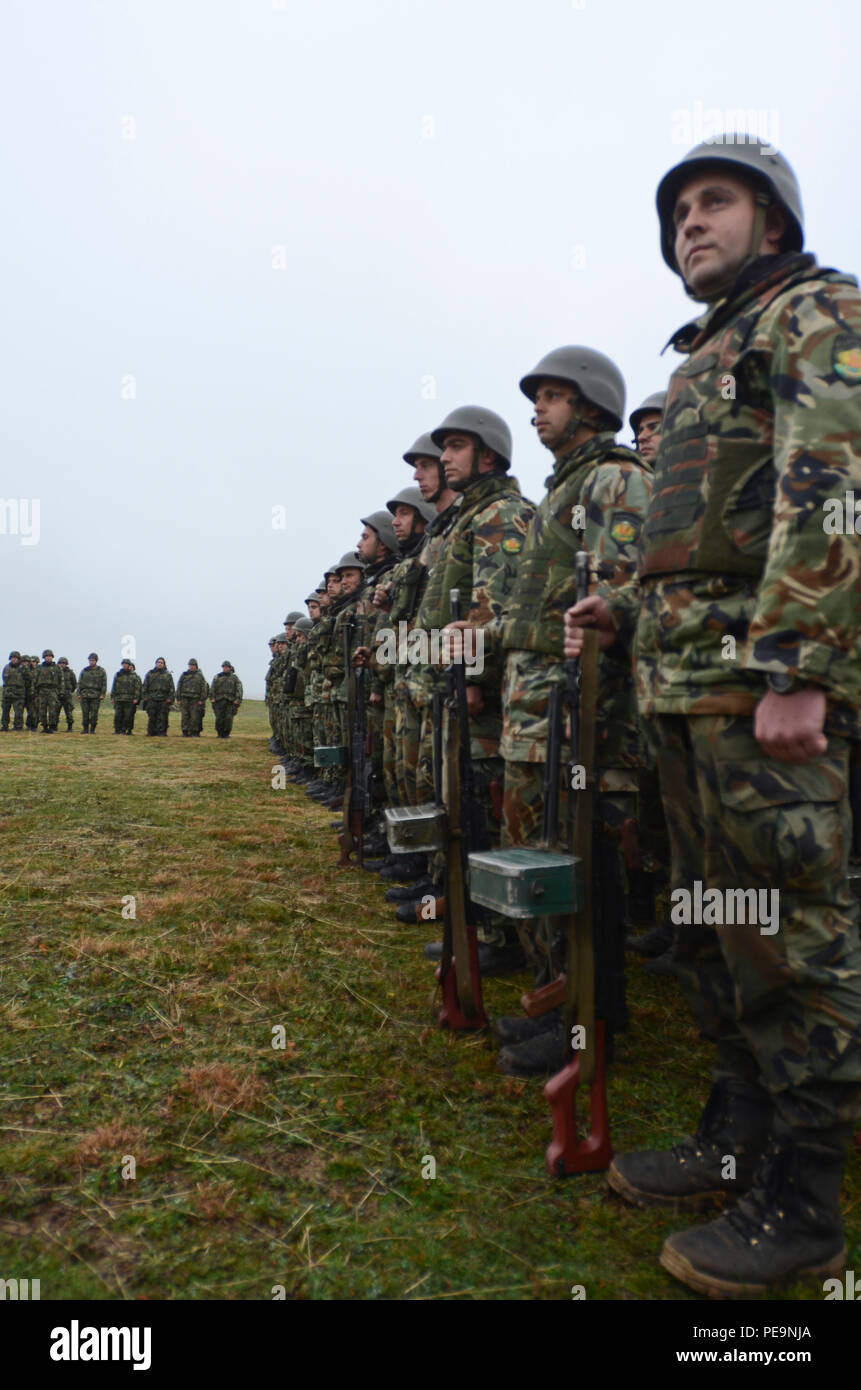 Bulgarian soldiers of 61st Mechanized Brigade stand in formation during the closing ceremony of Exercise Peace Sentinel at Novo Selo Training Center, Bulgaria, Nov. 24, 2015. (U.S. Army photo by Staff Sgt. Steven M. Colvin/Released) - Stock Image