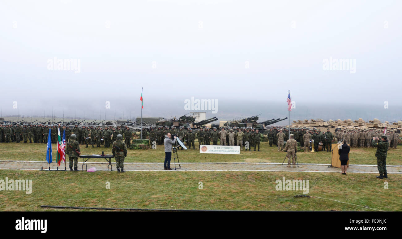 Key U.S. and Bulgarian Army leaders pose in front of the U.S. and Bulgarian Army formations for a photo during the closing ceremony of Exercise Peace Sentinel at Novo Selo Training Center, Bulgaria, Nov. 24, 2015. (U.S. Army photo by Staff Sgt. Steven M. Colvin/Released) - Stock Image