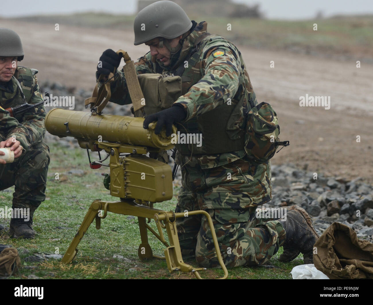 A Bulgarian soldier of 1-61st Mechanized Battalion sets up a 9M111M Faktoria anti-tank guided missile launcher during Exercise Peace Sentinel at Novo Selo Training Center, Bulgaria, Nov. 24, 2015. (U.S. Army photo by Staff Sgt. Steven M. Colvin/Released) - Stock Image