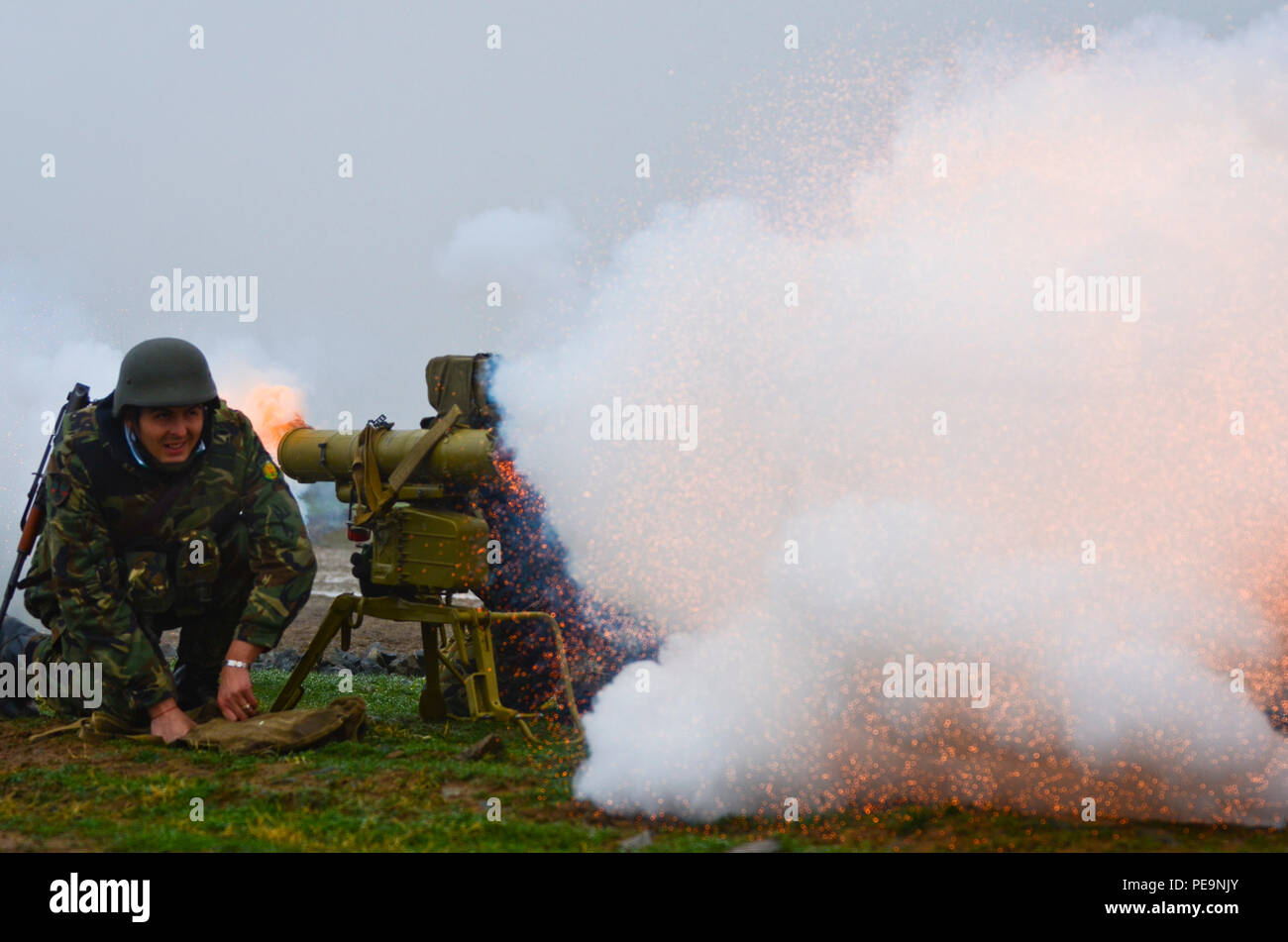 A Bulgarian soldier of 1-61st Mechanized Battalion fires a smoke cap out of a 9M111M Faktoria anti-tank guided missile launcher during Exercise Peace Sentinel at Novo Selo Training Center, Bulgaria, Nov. 24, 2015. (U.S. Army photo by Staff Sgt. Steven M. Colvin/Released) - Stock Image
