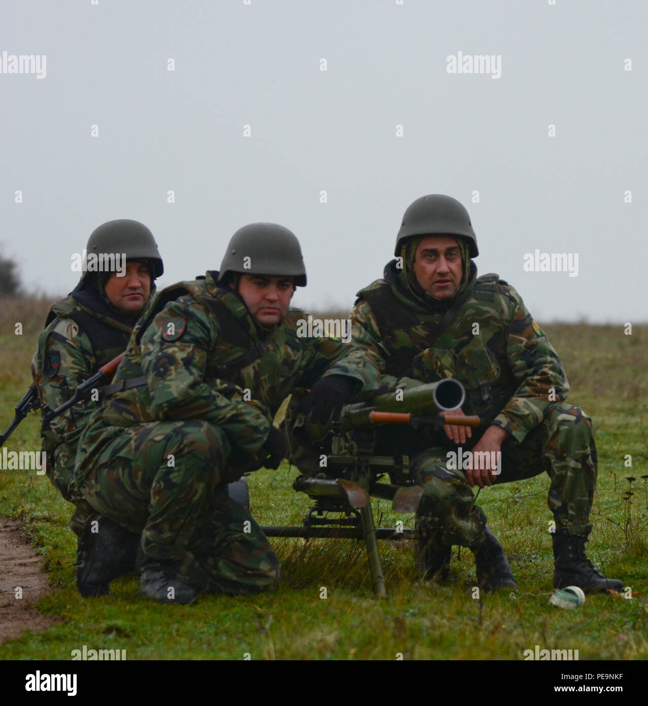 Bulgarian Soldiers of 1-61st Mechanized Battalion take their battle positions with an M20 Recoilless Rifle during Exercise Peace Sentinel at Novo Selo Training Center, Bulgaria, Nov. 24, 2015. (U.S. Army photo by Staff Sgt. Steven M. Colvin/Released) - Stock Image