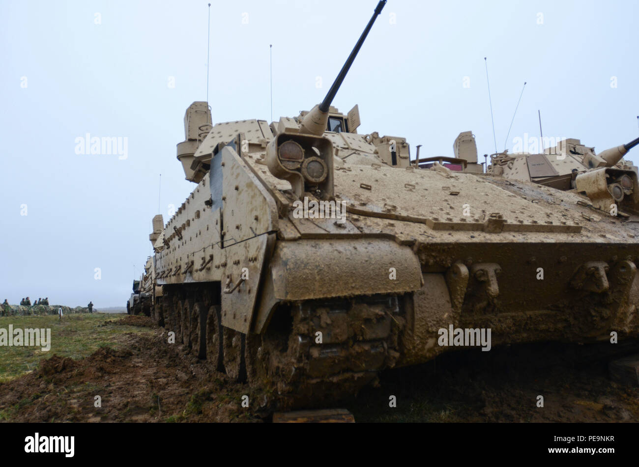 A U.S. Army Bradley Fighting Vehicle is covered with mud during Exercise Peace Sentinel at Novo Selo Training Center, Bulgaria, Nov. 24, 2015. (U.S. Army photo by Staff Sgt. Steven M. Colvin/Released) - Stock Image