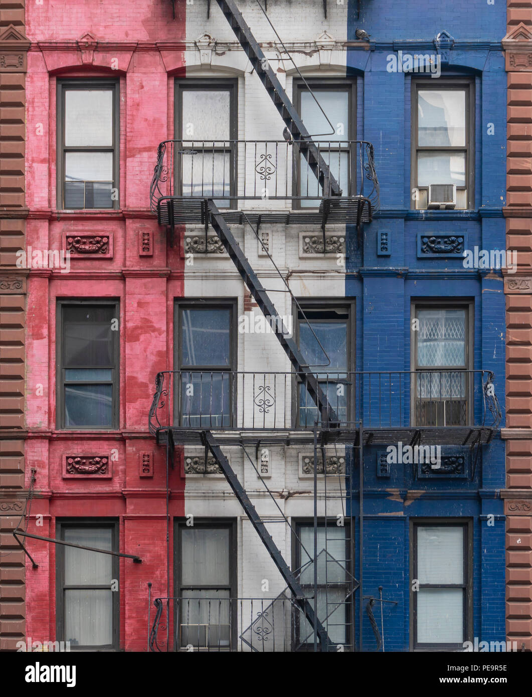 Fire escapes of a colorful building in New York City - Stock Image