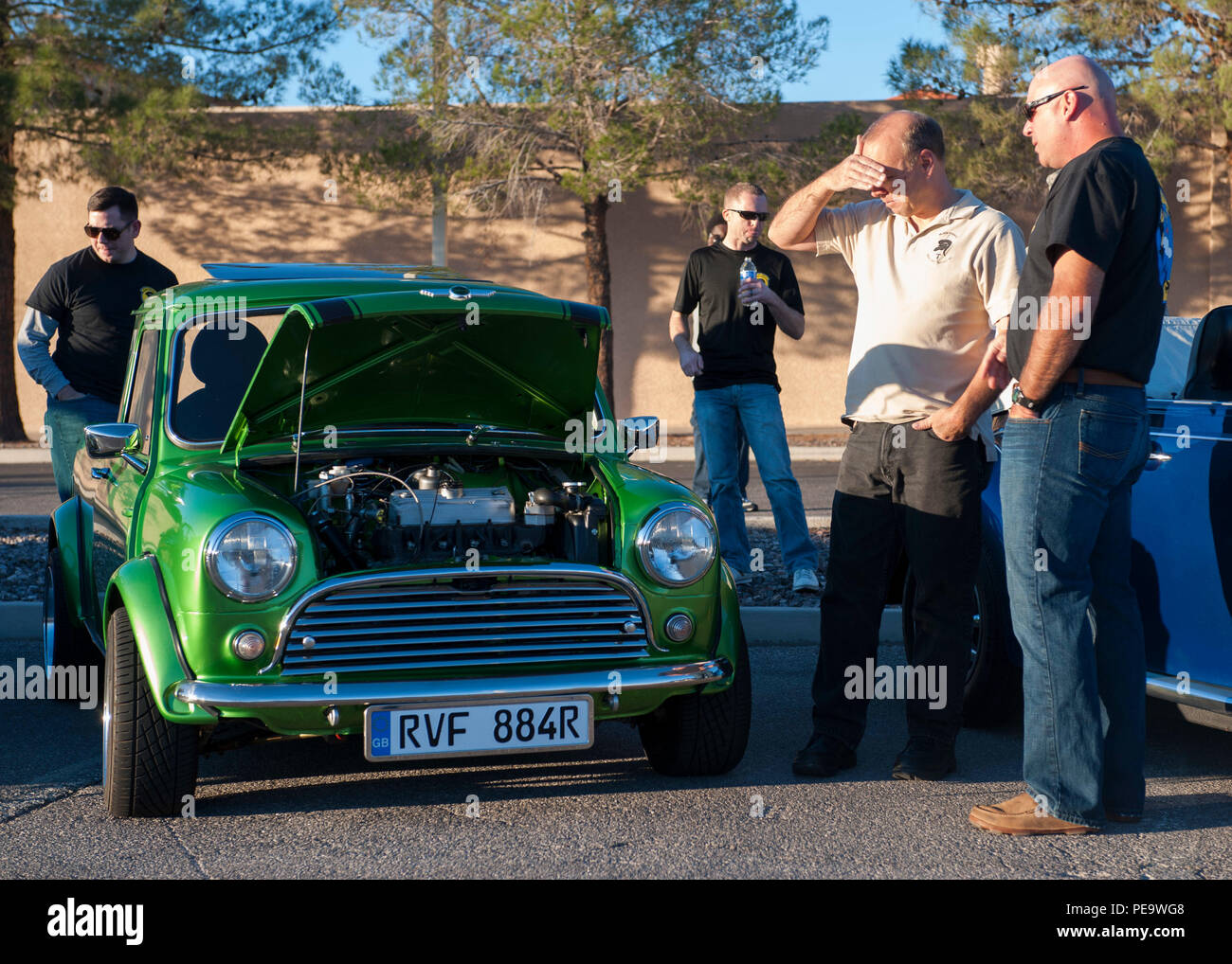 Participants In The Nellis Family Sports Day Inspect A Mini Cooper