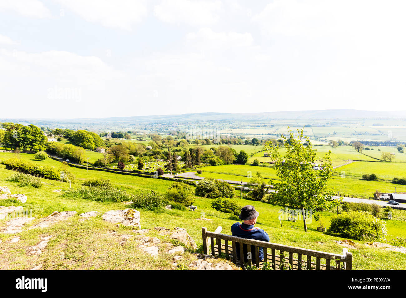 Loneliness, Man alone, man on bench, Man looking at Yorkshire Dales, man on Leyburn Shawl, Leyburn Shawl Yorkshire Dales UK, alone, loss, reminiscing, - Stock Image