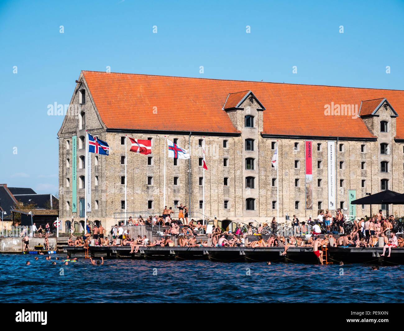 Swimmers and Sunbathers, North Atlantic House Arts Center Nordatlantens Brygge, Copenhagen, Zealand, Denmark, Europe. - Stock Image