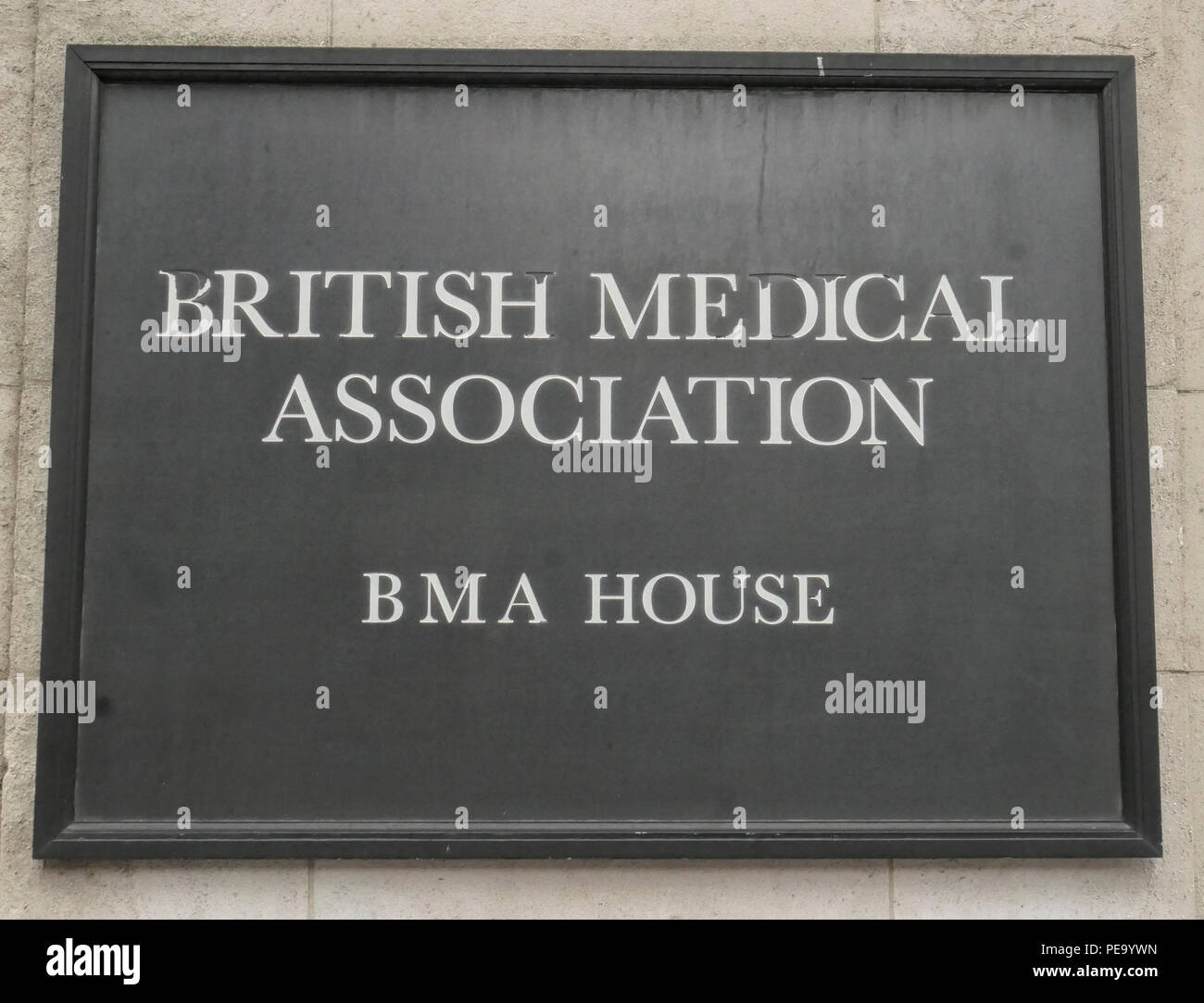 British Medical Association House wall sign in Tavistock Square London with worn down lettering - Stock Image