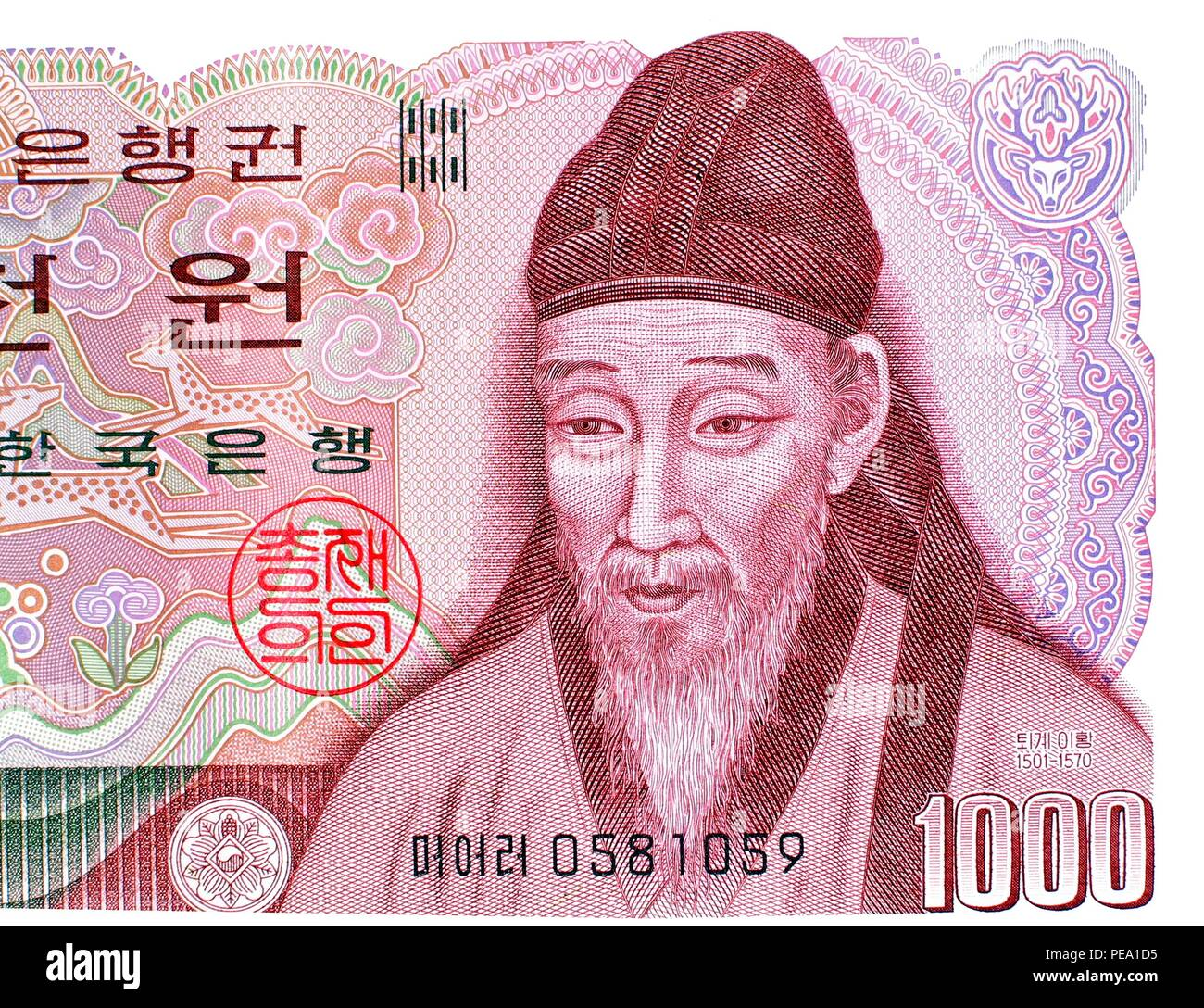 Detail on the South Korean 1000 Won banknote showing the portrait of the16th century Korean Confucian scholar Yi Hwang - Stock Image