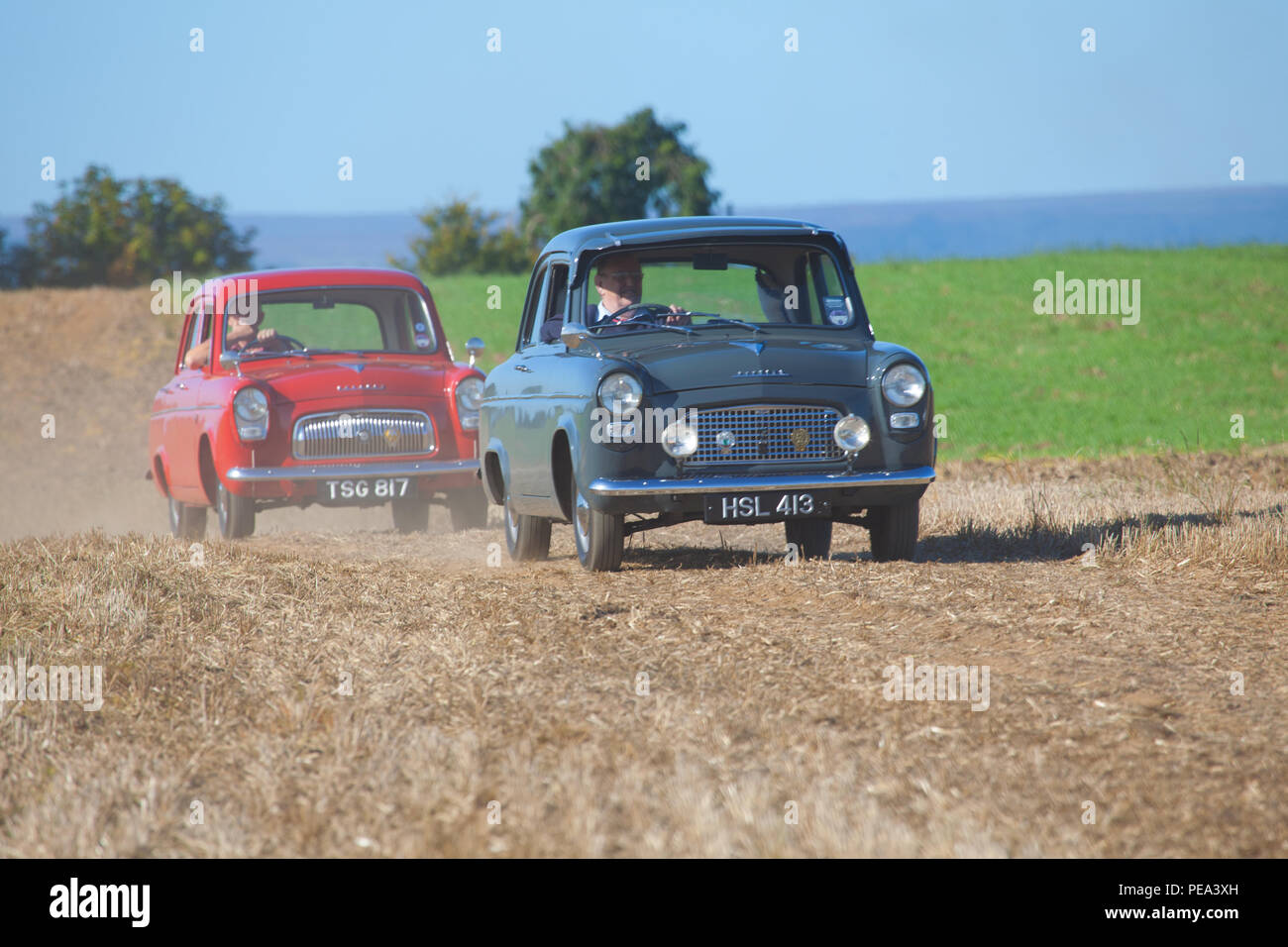 A Ford Popular & Ford Prefect arriving at a Classic Car Show in Ainderby,North Yorkshire Stock Photo