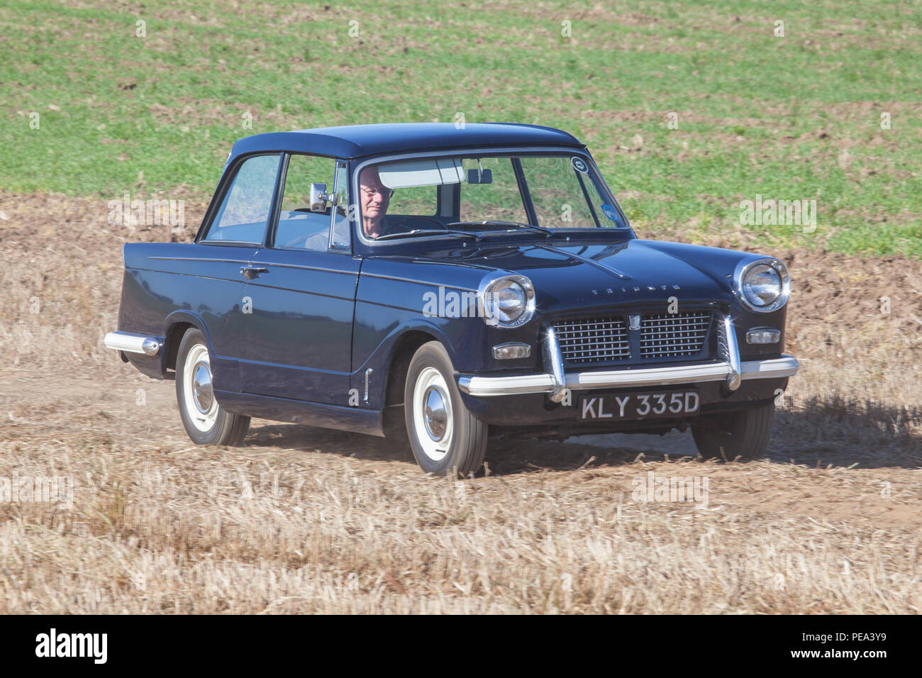 A 1966 Triumph Herald arriving to a Classic Car Show in Ainderby,North Yorkshire Stock Photo