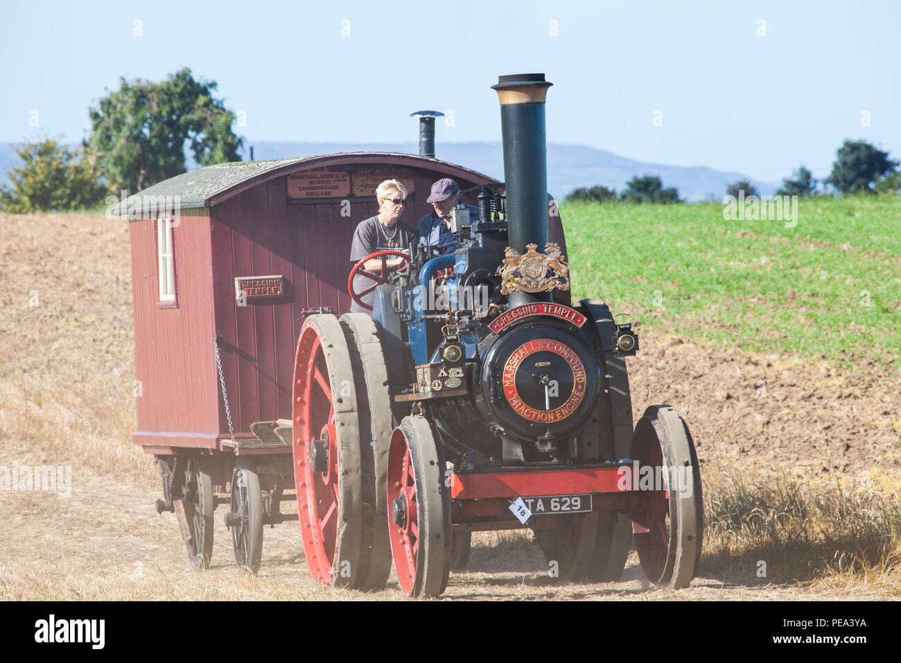 A Steam traction engine arriving at a Classic Car Show and Ploughin Match in Ainderby, North Yorkshire. Stock Photo