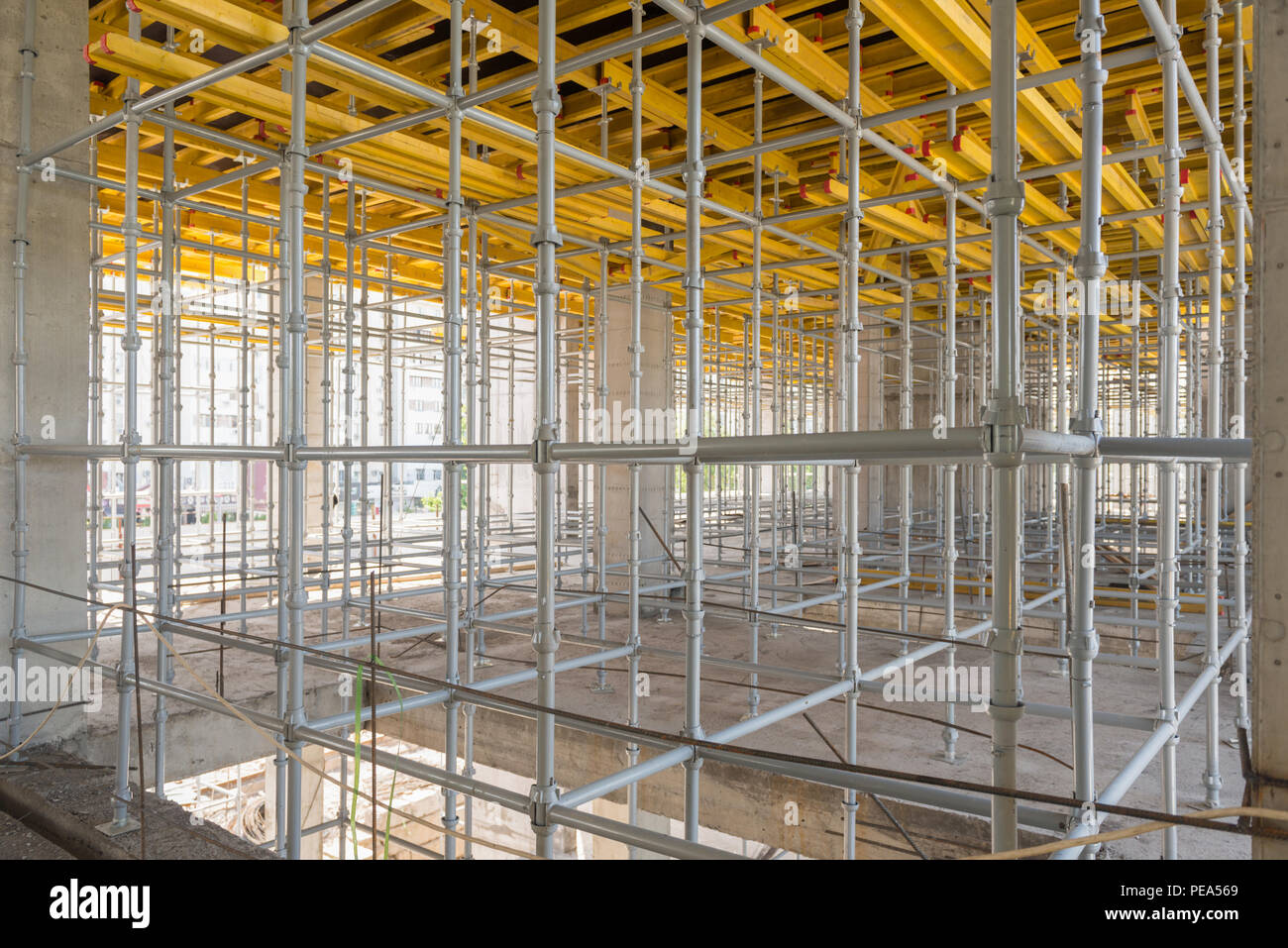 metal and wood scaffolding and supports, construction equipment Stock Photo