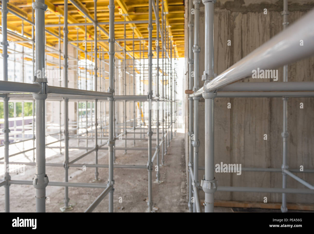 metal and wood scaffolding and supports, construction equipment - Stock Image