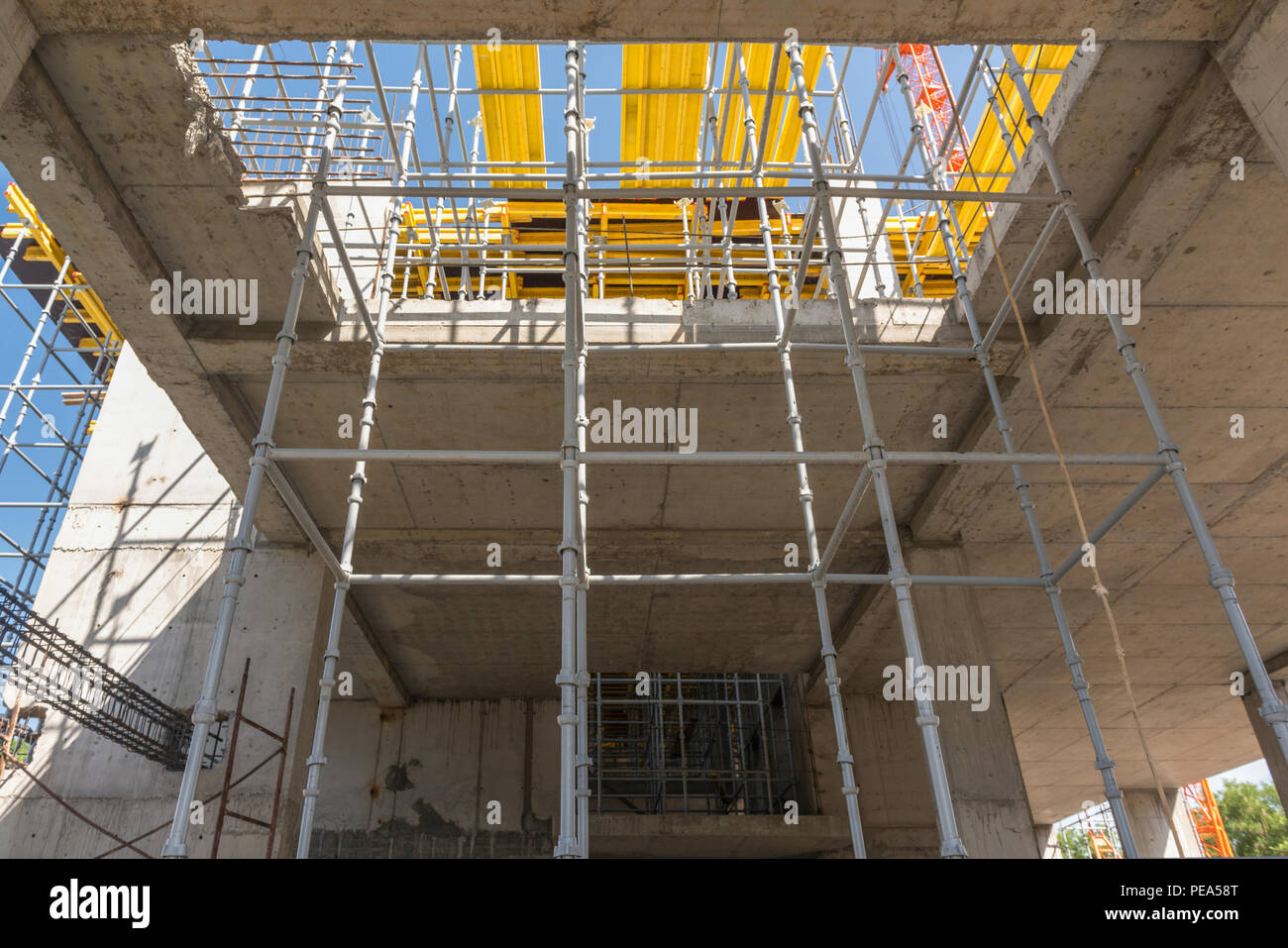 metal concrete structures of the building under construction. scaffolding and supports. bottom view - Stock Image