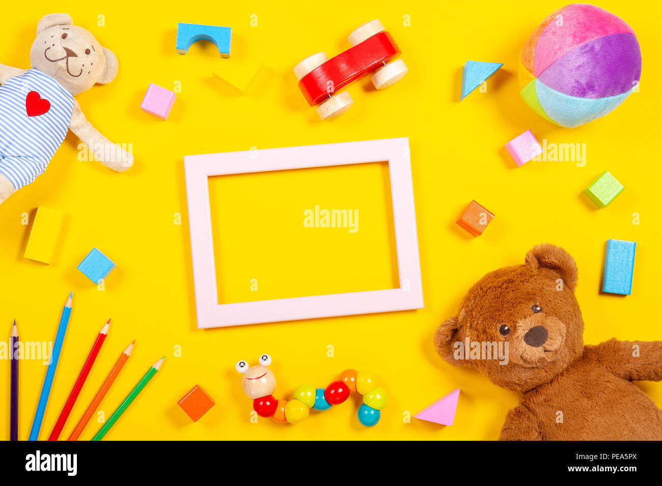 Baby Kids Toys Background With Empty Frame Colorful Wooden Soft Toys