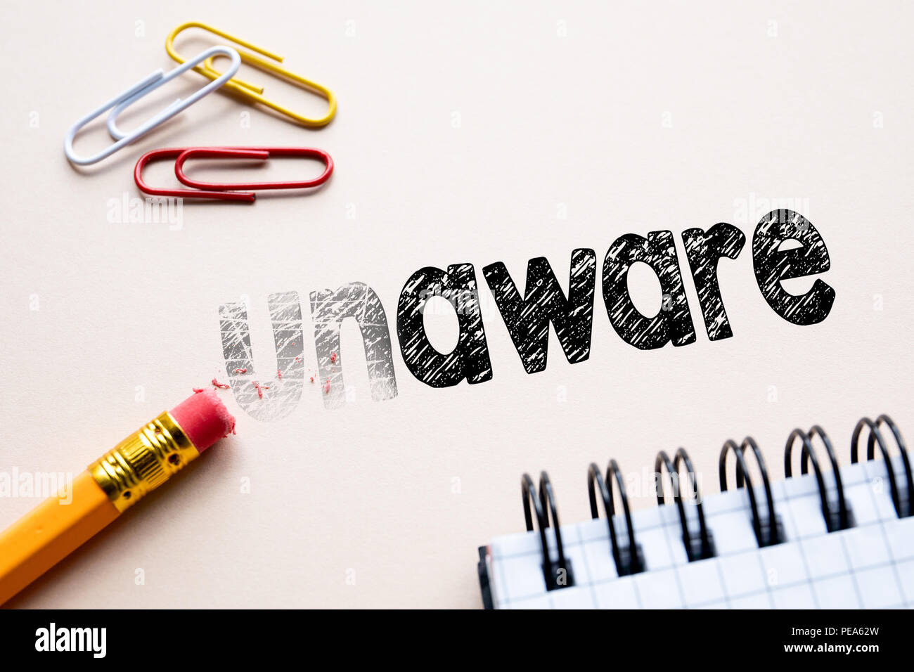 Making unaware in to aware by eraser - Stock Image