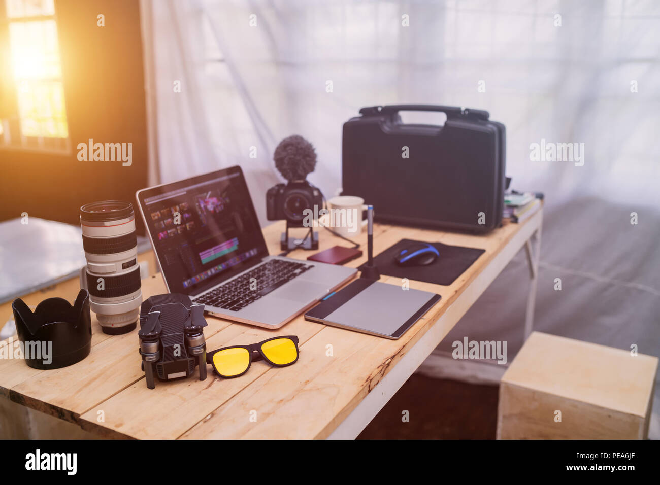 Desktop worker photographer the laptop Camera and drone gear