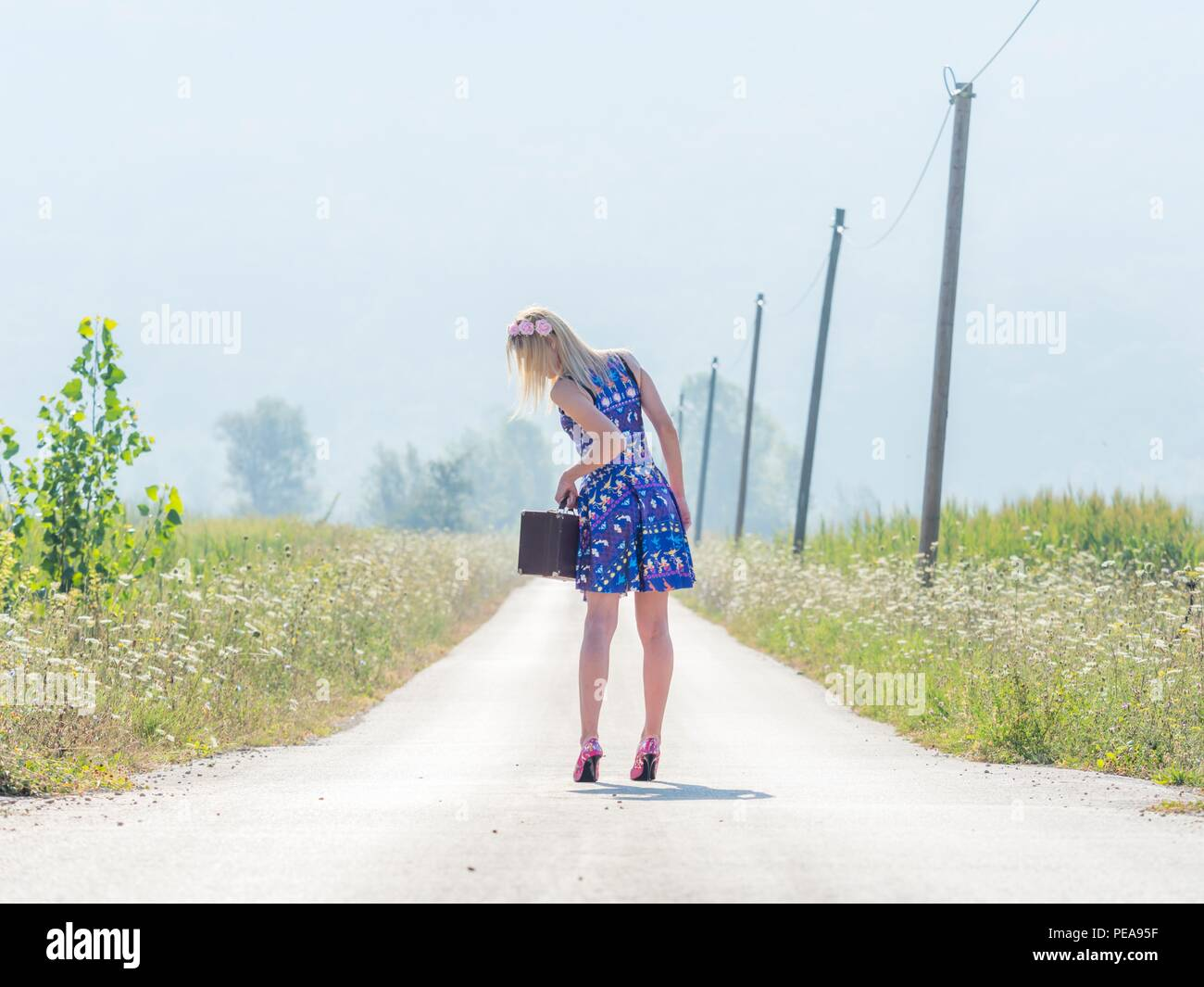 Sunlight mid-day 20s twenties attractive adult young woman outdoors run-away Stock Photo