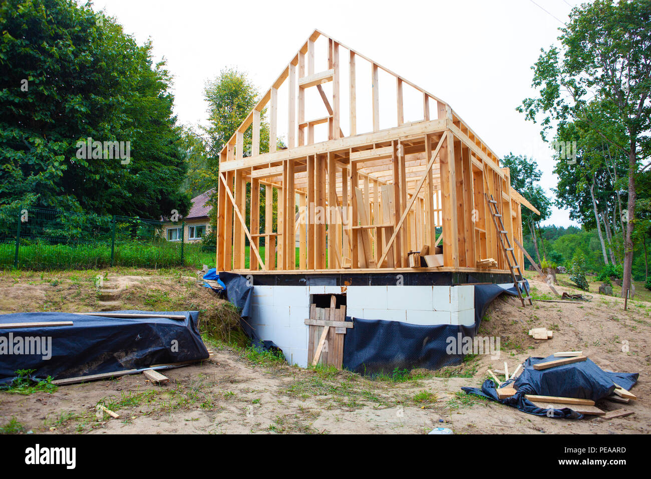 Stick built home under construction, new build roof with wooden truss, post and beam framework, timber frame house, real estate Stock Photo