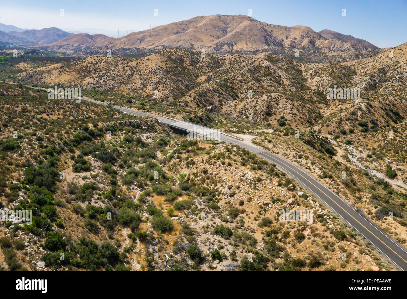 Bend in a highway in the hills of the desert of the American southwest. - Stock Image