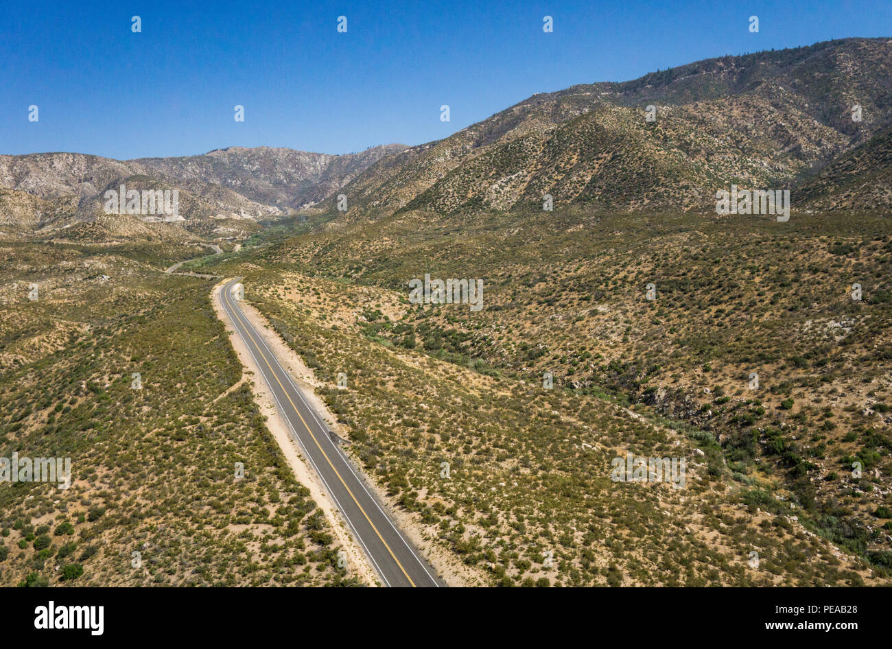 Highway in the Mojave Desert wilderness of southern California near Los Angeles. - Stock Image