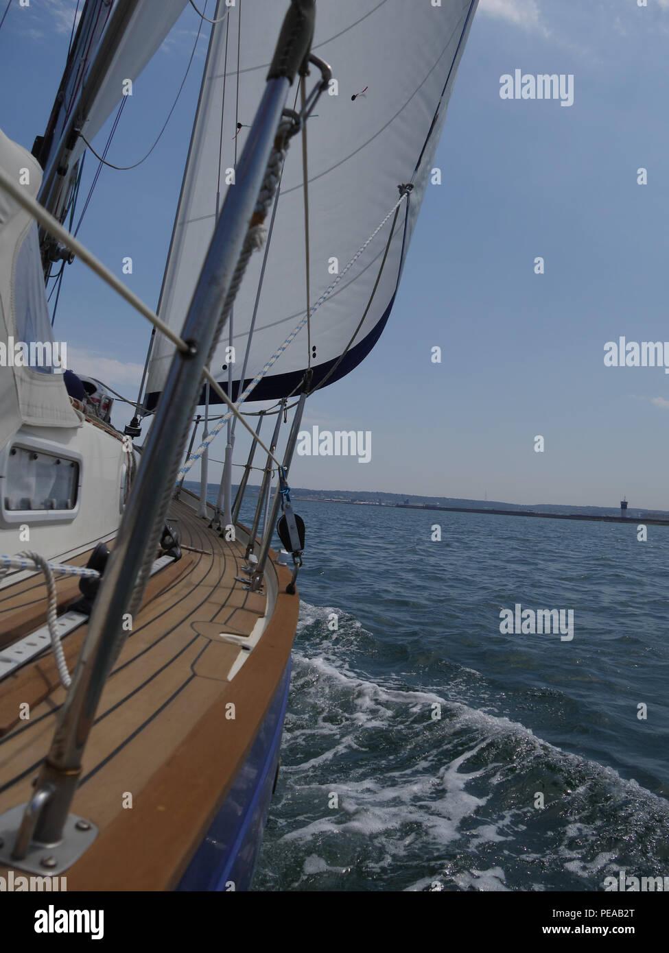 sailing yacht dashing through the water - Stock Image