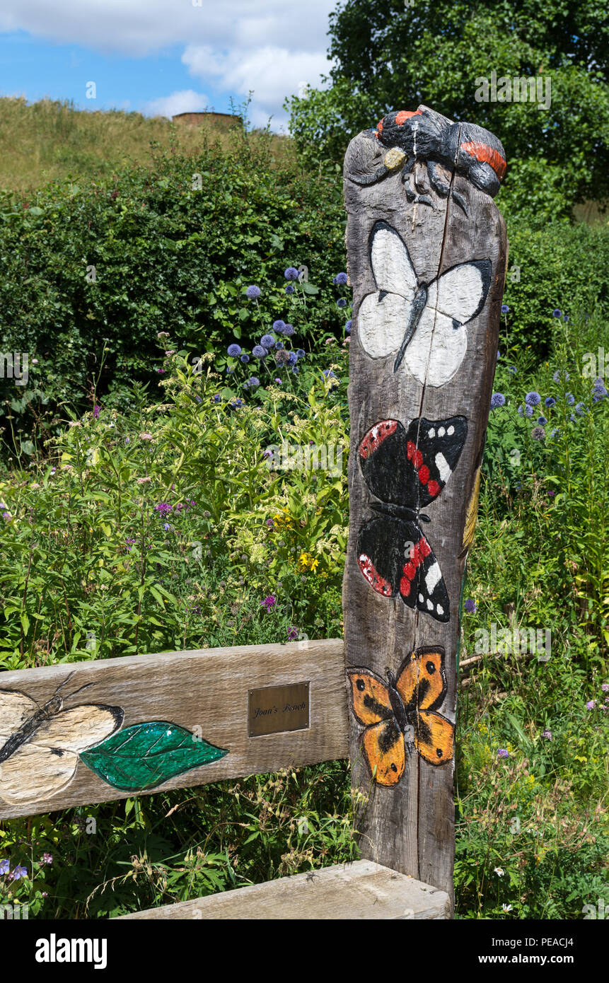 Wooden sign with painted butterfly replicas, Butterfly Garden, Sywell Country Park, Northamptonshire, UK - Stock Image
