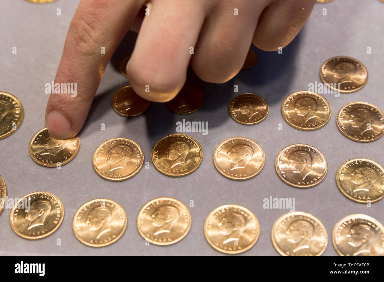 Gold Turkish lira coins Turk Lirasi 22 carat Ataturk image in The Grand Bazaar, Kapalicarsi, great market, Istanbul, Turkey Stock Photo