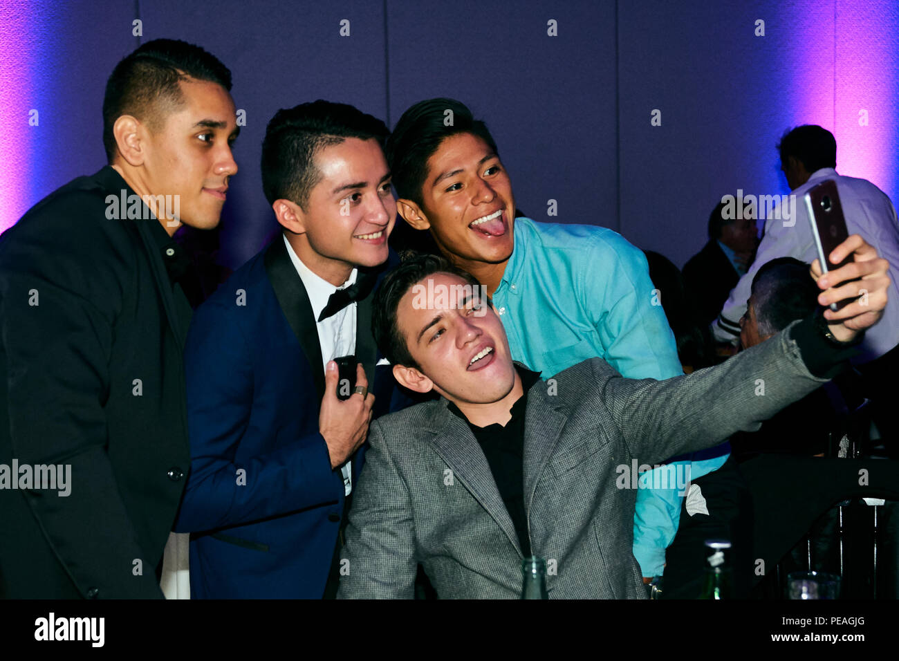 MERIDA, YUC/MEXICO - AUG 25, 2017: Portrait of a group of young men taking a selfie at their university's graduating party - Stock Image