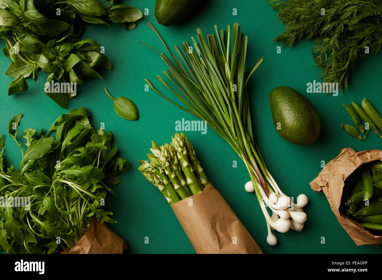 top view of various ripe vegetables on green surface - Stock Image