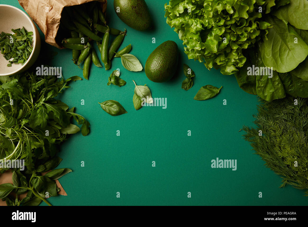 top view of different ripe vegetables on green surface - Stock Image