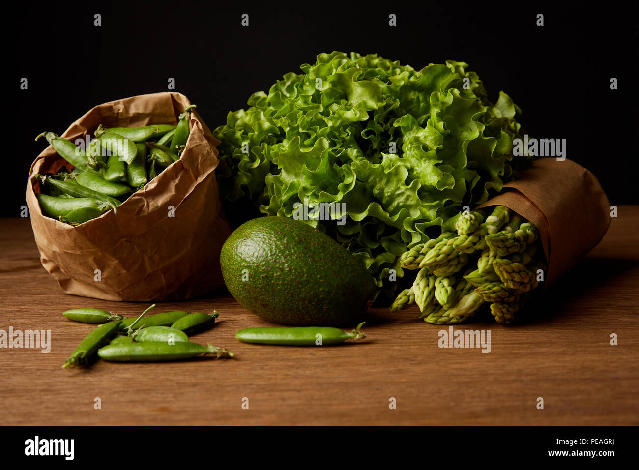 close-up shot of healthy green vegetables on wooden surface - Stock Image