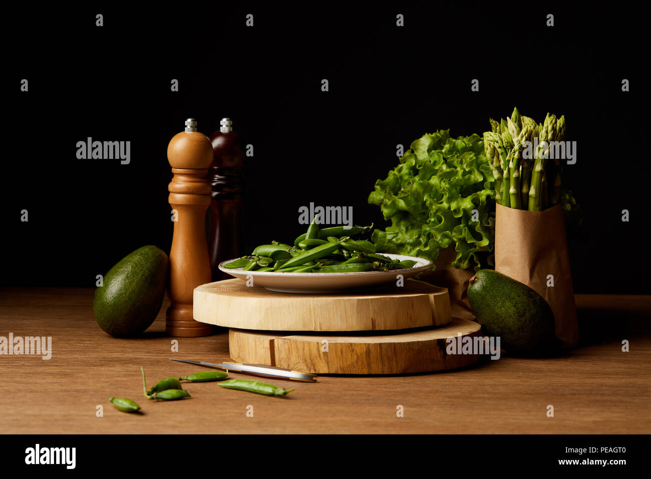 row green vegetables on wooden surface - Stock Image