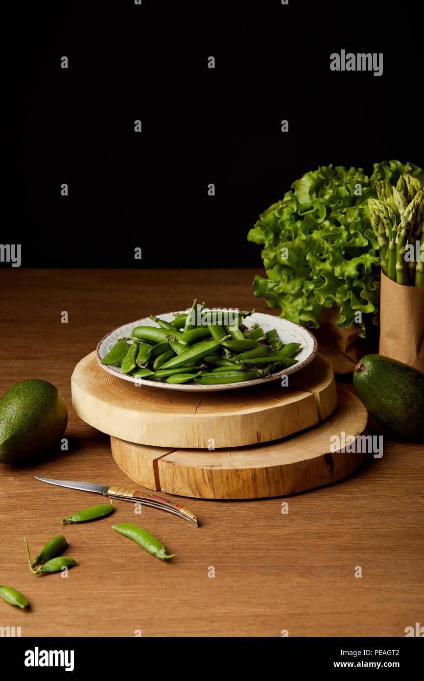 fresh green vegetables on wooden tabletop - Stock Image