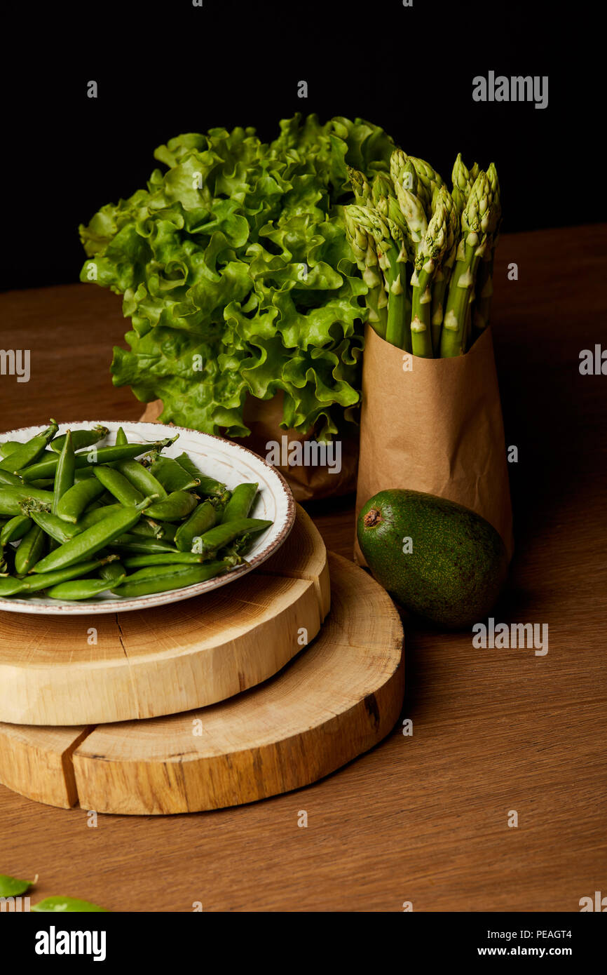 healthy green vegetables on wooden tabletop - Stock Image